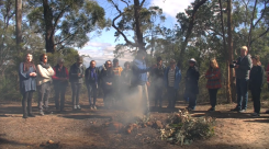 Dr Greg Blyton (Wollotuka) arranges smoking ceremony for students prior to access to the engraving site.